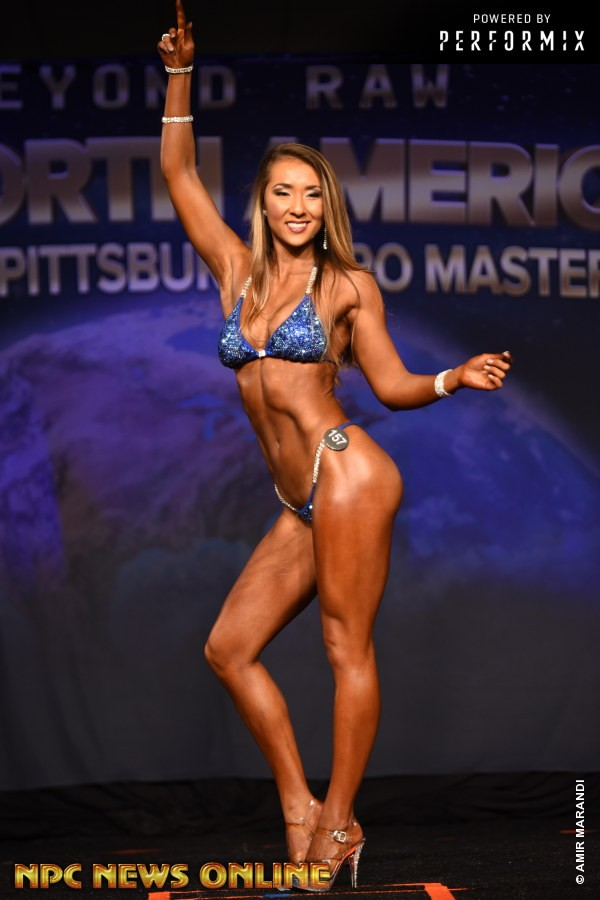 image of marissa on a national bodybuilding stage in 2018