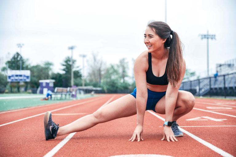 marissa stretching on a track